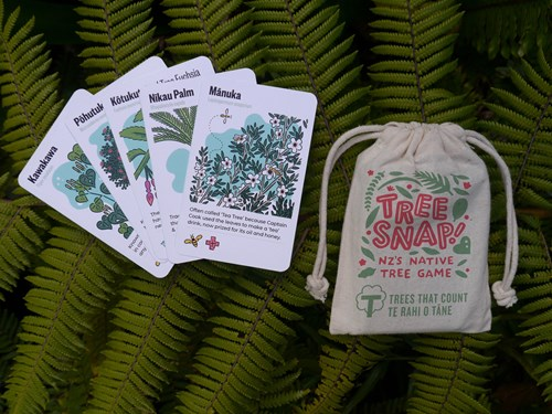 Tree Snap game in bag with cards laid out